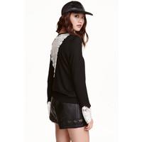 H&M Sweter z detalami z koronki 0418035002 Czarny
