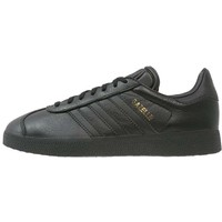 adidas Originals GAZELLE Tenisówki i Trampki core black/gold metallic AD112B0HD