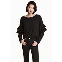 H&M Sweter z falbanami 0495918001 Czarny