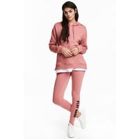 H&M Dżersejowe legginsy 0426541021 Różowy