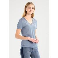 Lacoste TF3144-00 T-shirt z nadrukiem electric/vanilla plant LA221D03V